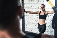 Happy sportswoman smiling and looking at her trainer Royalty Free Stock Photos