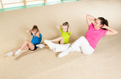 Happy sporty family in gym royalty free stock photo