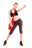 Happy sporty girl holds red gym bag ready for fitness exercise Royalty Free Stock Images
