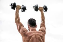 Happy and sporty. Healthy lifestyle. Muscular back man exercising in morning with barbell. athletic body. Dumbbell gym. Fitness and sport equipment. man stock photography