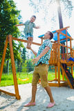 Happy sporty little boy standing on my father's arm Royalty Free Stock Photography