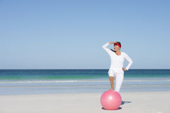 Happy sporty mature woman exercising beach Royalty Free Stock Image