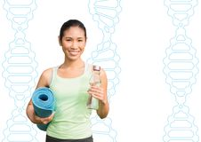 Happy sporty woman with dna chains background Royalty Free Stock Image
