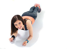 Happy sporty woman doing exercises on the floor Royalty Free Stock Photos