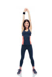 Happy sporty woman doing stretching exercise Stock Photo
