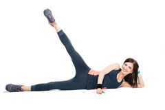 Happy sporty woman doing stretching exercises Royalty Free Stock Photo