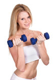 Happy sporty woman with a dumbbell Stock Images