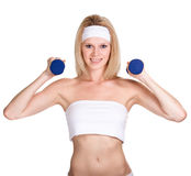 Happy sporty woman with a dumbbell Royalty Free Stock Photo