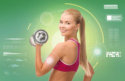 Happy sporty woman with dumbbell flexing biceps Stock Images