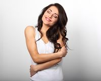 Happy sporty woman hugging herself with natural emotional enjoyi Royalty Free Stock Images
