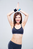 Happy sporty woman making yoga exercises Royalty Free Stock Photography