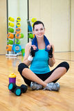 Happy sporty woman relaxing after training in gym Royalty Free Stock Photo