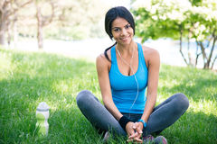 Happy sporty woman resting outdoors Royalty Free Stock Images
