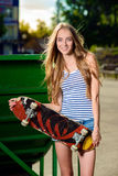 Happy sporty woman with skateboard Royalty Free Stock Photo