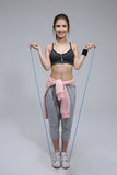 Happy sporty woman with skipping rope Royalty Free Stock Images