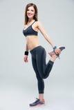Happy sporty woman stretching leg Royalty Free Stock Photo