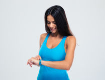 Happy sporty woman using fitness tracker Royalty Free Stock Photography
