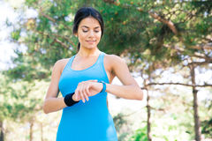 Happy sporty woman using smart watch Royalty Free Stock Photo