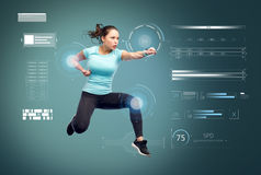 Happy sporty young woman jumping in fighting pose Royalty Free Stock Images