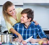 Happy spouses filling forms for joint banking Stock Photo