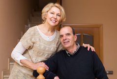 Happy spouses leaning against stairway Royalty Free Stock Image