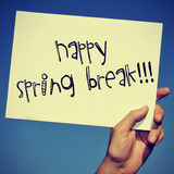Happy spring break. A man hand holding a signboard with the text happy spring break written in it royalty free stock photos