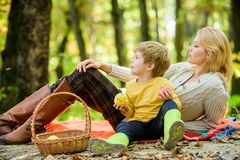 Happy spring day. Spring mood. Happy family day. Sunny weather. Healthy food. Happy son with mother relax in autumn. Forest. Family picnic. Mothers day. Mother royalty free stock image