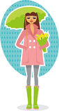 Happy spring girl. Happy girl with yellow tulips and green umbrella standing under the spring rain Stock Image