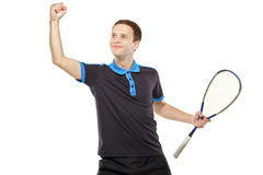 A happy squash player celebrating a score Stock Photos