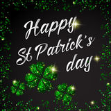 Happy St. Patrick Day lettering background with glitter clove Stock Photos