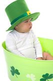 Happy St. Patrick's Day. Adorable little baby in the studio wearing festive clothes for St. Patrick's Day Royalty Free Stock Photography