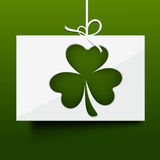 Happy St. Patricks Day celebration with hanging card. Royalty Free Stock Photos