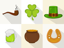 Happy St. Patricks Day celebration object set. Happy St. Patricks Day celebration ornaments with smoking pipe, clover leaf, leprechauns hat, beer, earthenware Stock Photo