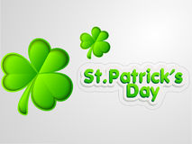 Happy St. Patricks Day celebration with shamrock leaves. Happy St. Patricks Day celebration with glossy Irish lucky shamrock leaves on grey background Stock Photography