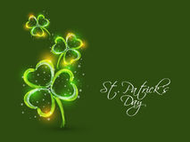 Happy St. Patricks Day celebration with shamrock leaves. Happy St. Patricks Day celebration with shiny shamrock leaves design on green background Stock Photos