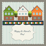 Happy St. Patrick`s Day Greeting Card / Poster. With Colorful Houses Royalty Free Stock Photography