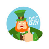 Happy St.Patrick `s Day. Leprechaun winks. Dwarf with red beard. Thumbs up. Irish elf emotions. Holiday in Ireland Stock Photography