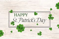 Happy St. Patrick`s day. st patricks day design with falling shamrock, four leaved clover on wooden background. Ireland. Symbol pattern. Design for banner, card Stock Image