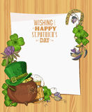 Happy St. Patrick's day template. Wooden texture background with clover. Paper Royalty Free Stock Photos