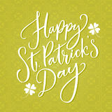 Happy St. Patrick`s day text. Typography greeting at green celtic background. Vector modern calligraphy. Royalty Free Stock Photos