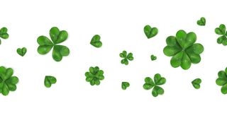 Happy St. Patrick`s day vector horizontal seamless background with shamrock, four leaved clover isolated on white. Background. Ireland symbol pattern. Design Stock Photos