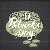 Happy St Patrick`s Day Vintage greeting card Hand lettering on leprechaun pot of gold coins silhouette, Irish holiday grunge textu Stock Photo