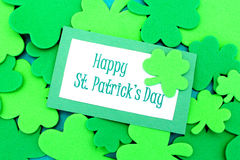 Happy St Patricks Day. Tag over shamrock background Stock Photography