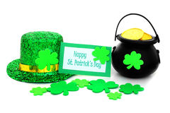 Happy St Patricks Day. Tag with pot of gold, hat and shamrocks over white Royalty Free Stock Photos