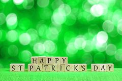 Happy St Patricks Day blocks with twinkling green background Stock Photography