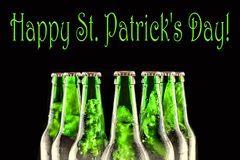 Happy St. Patricks Day Chilled beer. Brewed beer in bottles on a black background. Happy St. Patrick`s Day Chilled beer. Brewed beer in bottles on a black Stock Image