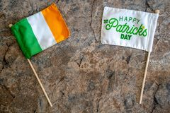 Happy St Patricks Day flag with an Ireland flag. Concept for St Patricks Day. Flatlay on marble background.  stock images