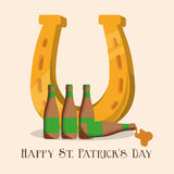 happy st patricks day golden horseshoe and bottle beer Stock Photography