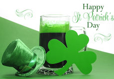 Happy St Patricks Day green beer in large glass stein with sample text. Happy St Patricks Day green beer in large glass stein with shamrocks and leprechaun hat Stock Images