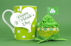 Happy St Patricks Day green cupcake with coffee Royalty Free Stock Image